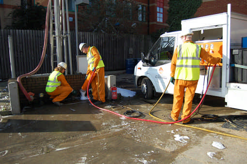 Operatives using Nitro-foam to clean fuel tank prior to removal and disposal
