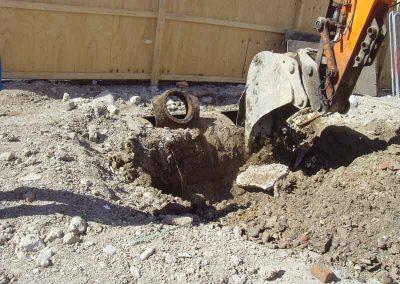 Excavator exposing fuel tanks